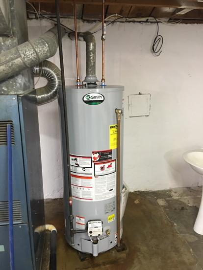 AO Smith water heater installed with solid gas line.