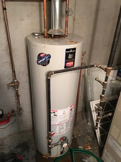 Hot water heater leaking from top of tank