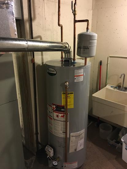 thermal expansion tank supported by water heater