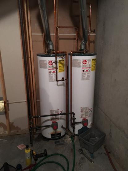 rheem water heater leaking